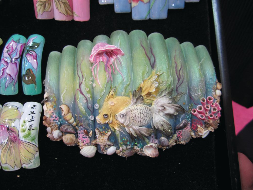 <p>Liliya and Reiner Engel of Engel Nail Kos have an academy and sell a quarterly nail art book with Liliya&rsquo;s beautiful art. She did this ocean-themed 3-D acrylic set.</p>