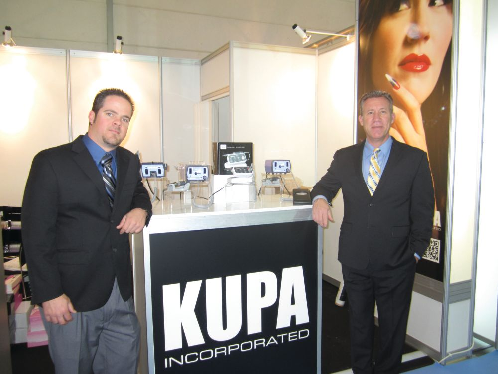 <p>Robert Arthur and Richard Hurter were familiar faces in the sea of nail booths in Germany. The electric file company had a small booth compared to some of the massive ones on the show floor, but the guys were busy all three days of the show.</p>
