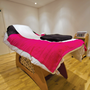 Even the multi-use treatment rooms are full of hot pink towels to maintain the salon's...
