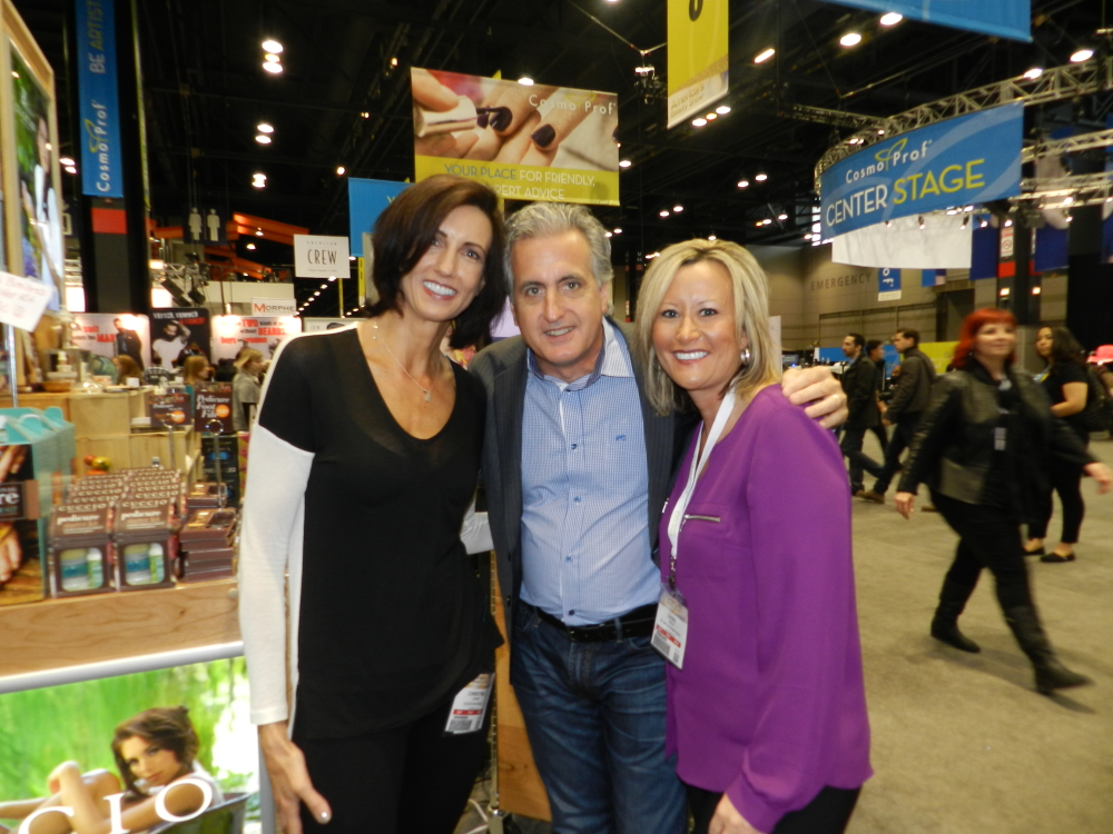<p>Cuccio&rsquo;s Christina Jahn and Robert Novak pal around with BTB rep Dawn Holz. Cuccio had two booths on the show floor, one dedicated to the Cuccio Naturale line and the other dedicated to Cuccio Colour and Veneer.&nbsp;</p>