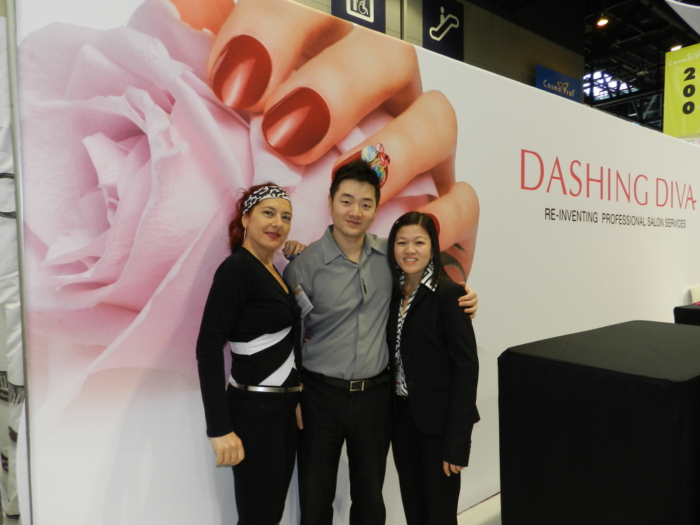 <p>Dashing Diva&rsquo;s Arpi Sekeryan, Justin Choi, and Michelle Dao stressed the safety benefits of using the company&rsquo;s Nail Guard under gel-polish.</p>