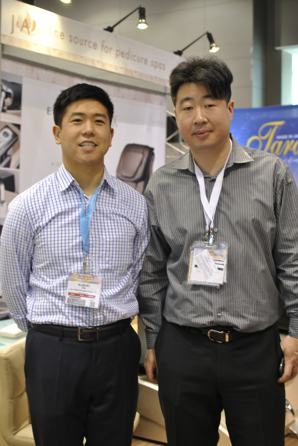 <p>J&amp;A&rsquo;s Albert Kim and Mike Ahn showed off the company&rsquo;s new adjustable foot rest.</p>