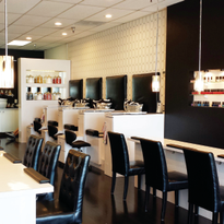 GLO's decor consists of a simple color palette of black and white to highlight the wide...