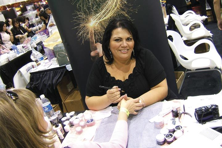 <p>Entity educator Lorena Marquez smiles while doing demos at the booth.</p>