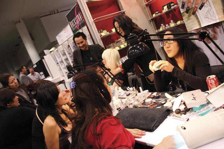 <p>Odyssey Nail Systems team competitor Amy Oung (right) entertained questions while doing a demo with a show attendee.</p>