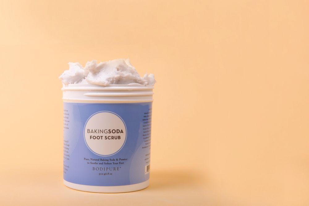 """<p>The Baking Soda Foot Scrub from <a href=""""http://www.bodipure.com/?sl=EN"""" target=""""_blank"""">BodiPure</a> leaves feet feeling clean and refreshed. The natural properties of baking soda are enhanced with pumice grains to effectively deodorize and soften feet, and hints of cooling peppermint essential oil will awaken all the senses. <br /><br /></p>"""