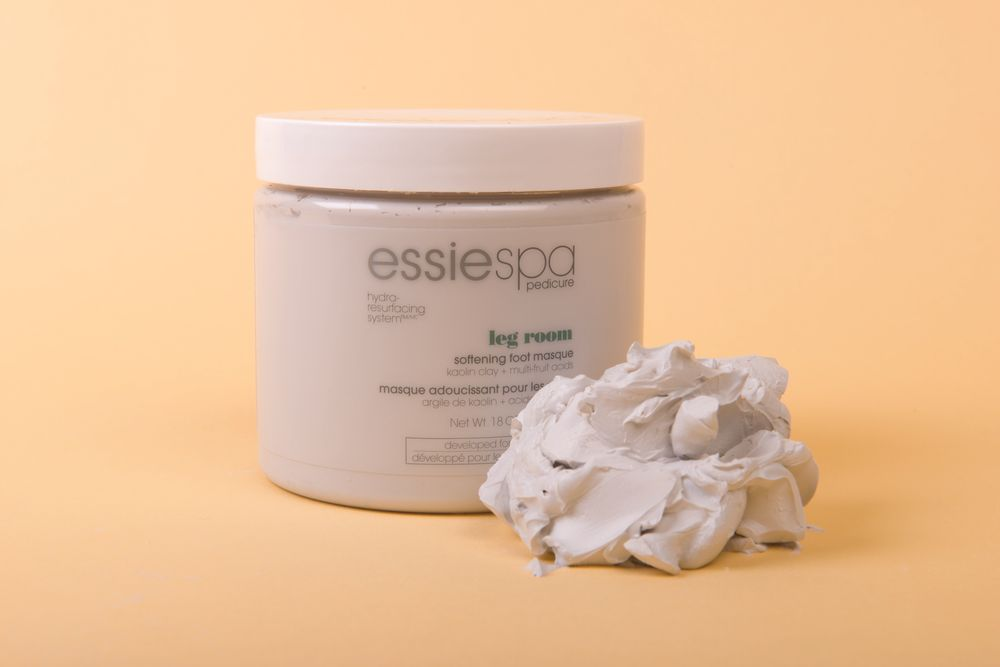 """<p>Leg Room Softening Foot Masque, one product of <a href=""""http://www.essie.com/Essie-Expertise.aspx"""" target=""""_blank"""">Essie</a>&rsquo;s &shy;EssieSpa pedicure line, infuses skin with nourishing moisture, and the fragrances relax and revitalize the mind, body, and &ldquo;sole.&rdquo; This mask gently draws impurities from skin for an exquisite exfoliating cleanse. <br /><br /></p>"""