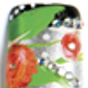 Swirl together red and white paint on the nail to form two flowers. Add rhinestone accents, and...