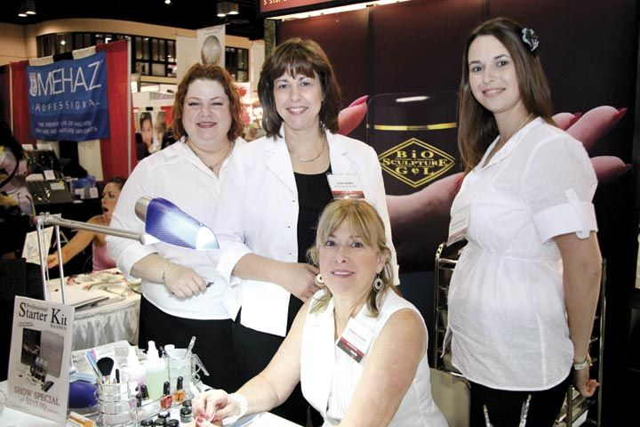 <p>Michelle McLandon, Elsie Visser, Rhonda Tooker, and Melanie Visser worked the Bio Sculpture booth demonstrating products from the Professional Starter Kit.</p>