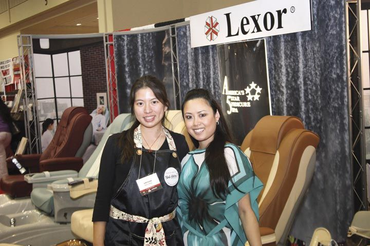 <p>VietSALON associate editor Kim Pham and Lexor&rsquo;s Jennifer Nguyen pose in front of some of Lexor&rsquo;s pedicure spa chairs.</p>