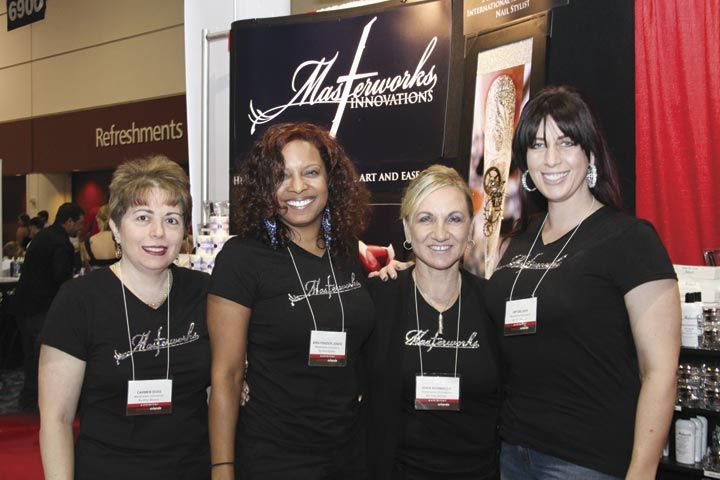 <p>Masterworks Innovations&rsquo; Carmen Doss, Kira Frazier-Jones, Sher Schwader, and owner Amy Becker performed pink-and-white and fill demos at the booth.</p>