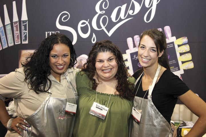 <p>It&rsquo;s So Easy&rsquo;s Angie McGhee, Rita Padilla, and first time show-goer Bean Kushner entertained customers with new striper and polish colors.</p>