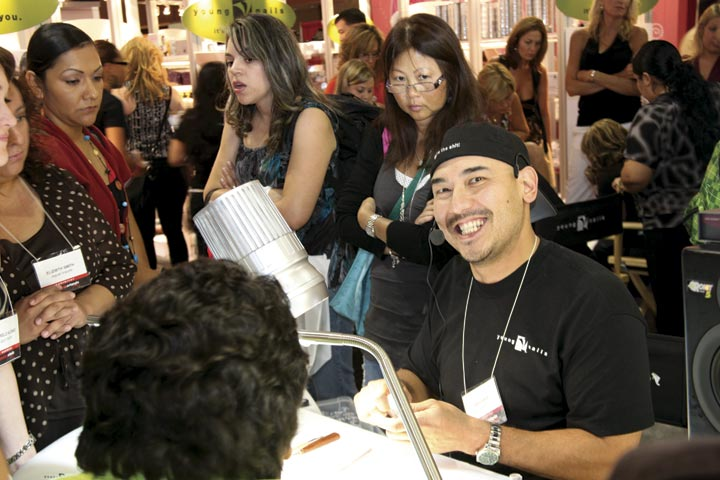 <p>Young Nails&rsquo; Greg Salo used a hands-free mic and speaker system to help the crowd hear him over the roar of the show floor.</p>