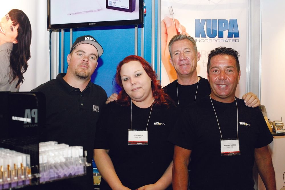 <p>Mashall Himmel (right) joins Kupa each year in Orlando to fix Kupa e-files on-site. He&rsquo;s joined by Kupa&rsquo;s Robert Arthur, Sara Smith, and Richard Hurter.</p>