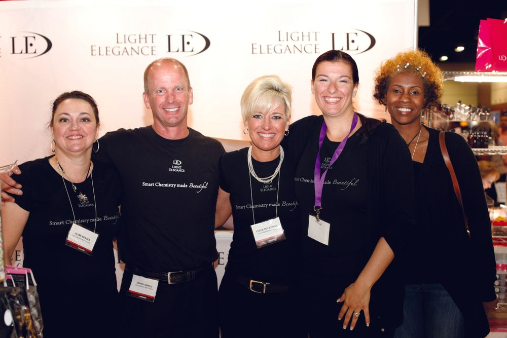 <p>Light Elegance&rsquo;s Jayne Berger, Jim McConnell, Lezlie McConnell, Josephine More, and good friend Tiffany Carter keep their motto &mdash; &ldquo;smart chemistry made beautiful&rdquo; &mdash; close to their hearts.</p>