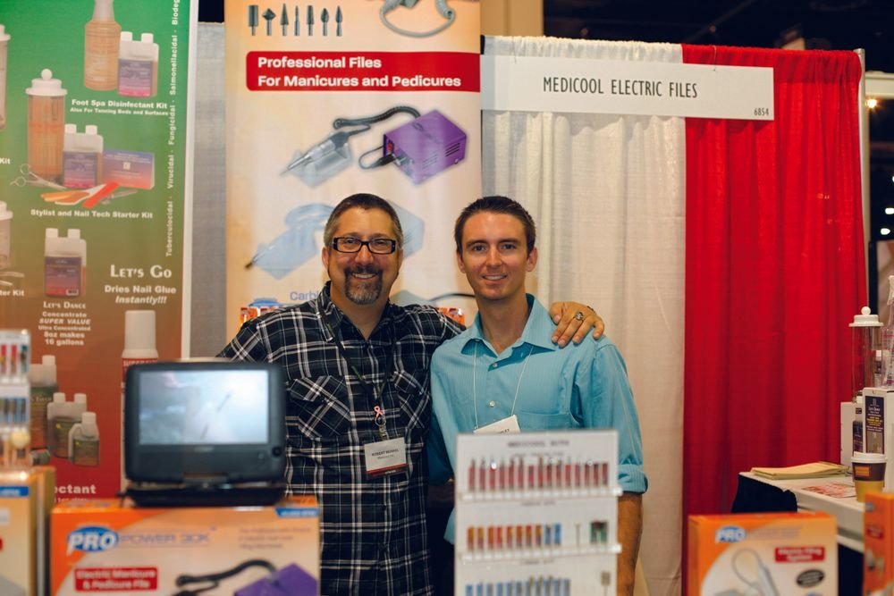 <p>NAILS senior editor Tim Crowley (right) pals around with Medicool&rsquo;s e-file educator Robert Munkel, a.k.a. The &ldquo;Drill&rdquo; Sarge.</p>