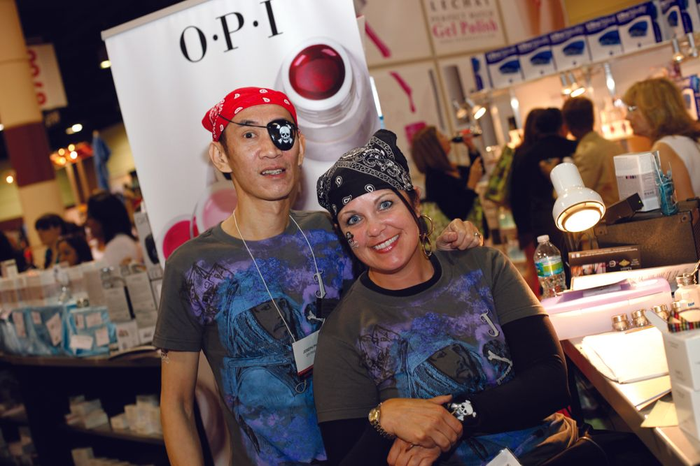 <p>In celebration of its new OPI Pirates of the Caribbean polish line, all the educators at the OPI booth donned scarves and eye patches, including educators Joseph Pham and Wendy Brownlee.</p>
