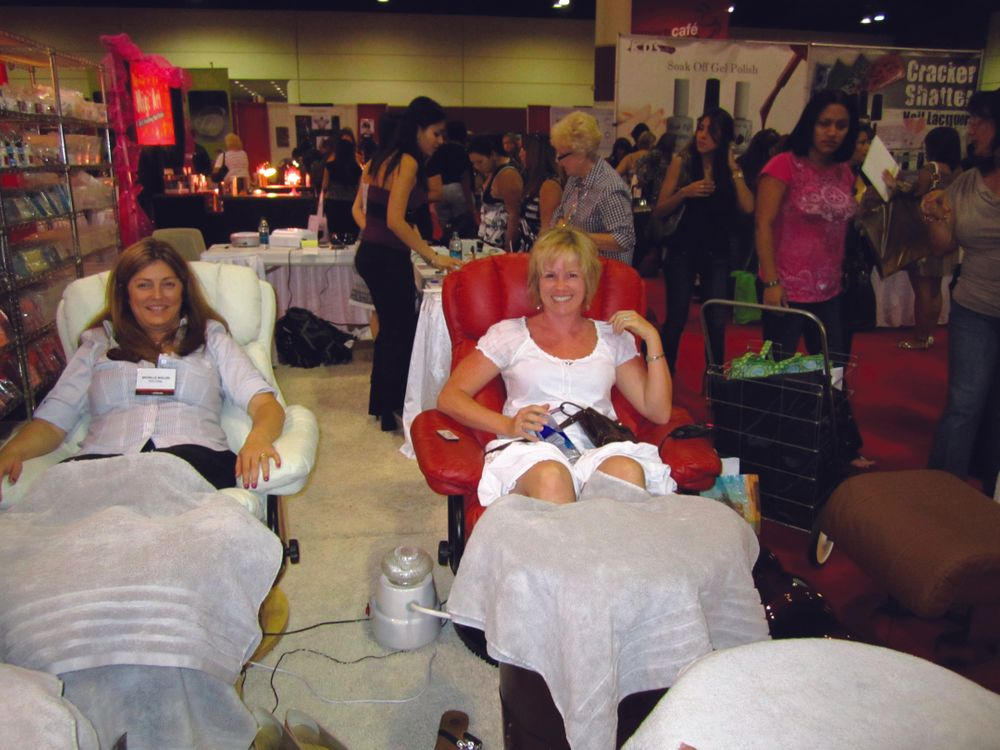 <p>NAILS&rsquo; Michelle Mullen and Casey Forte from Nails by Casey in Ocala, Fla., enjoyed a seat in The Nail Superstore&rsquo;s new Red Dragon Sauna chair, which replaces the traditional water basin with steam.</p>