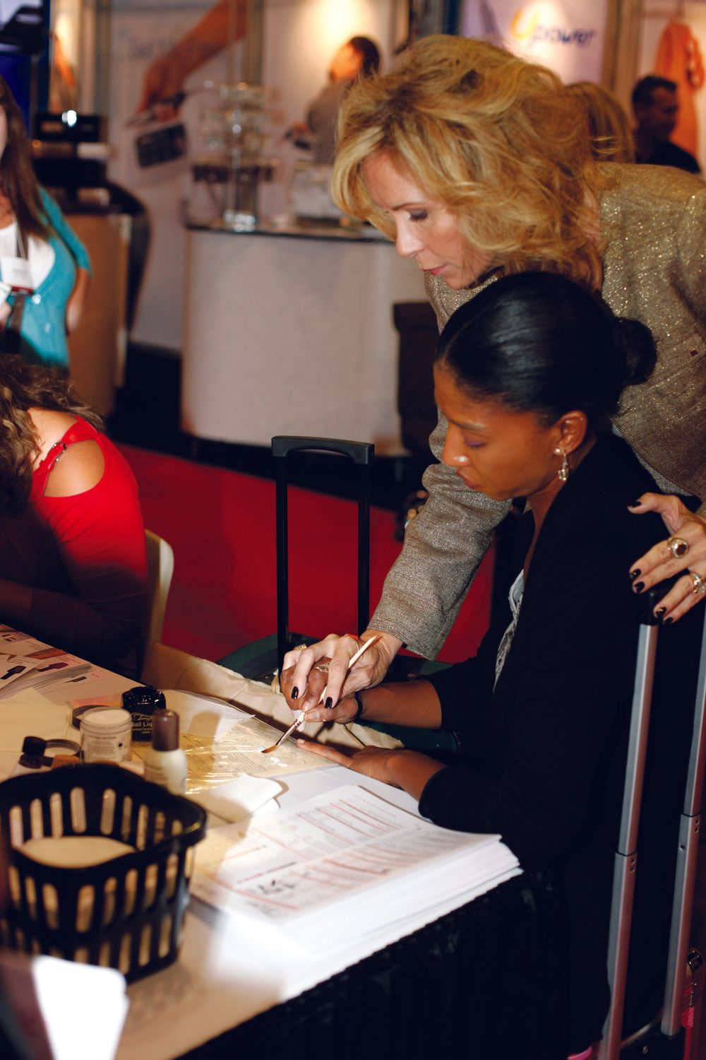 <p>Tammy Taylor took an honest-to-goodness hands-on approach to teaching. She guided House of Nails owner Valerie Sam&rsquo;s hand so she could really get a feel for Taylor&rsquo;s technique of creating perfect pink-and-white acrylic nails.</p>