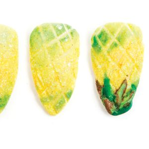 1. Marble in some green acrylic with yellow and clear glitter and cover the whole nail...