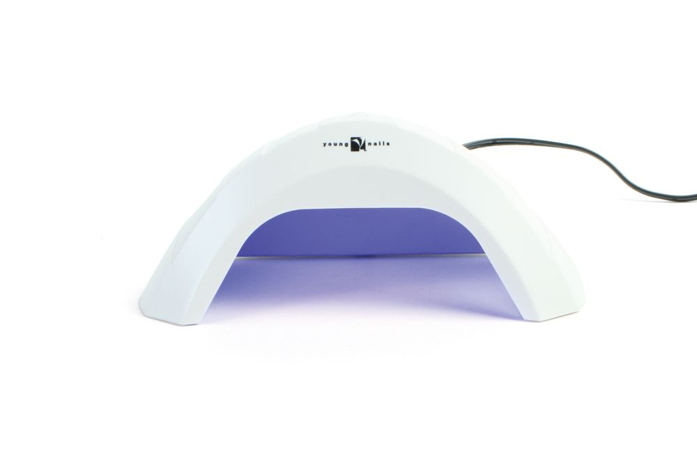 """<p>Small and compact, <a href=""""http://www.youngnails.com/"""">Young Nails</a>&rsquo; mini LED light is ideal for the nail tech on the go or one who wants more space at her nail station. The mini lamp comes with a 30-second timer and automatic shut off and can be used on both hands and feet. A 40,000 hour lifetime ensures plenty of use.</p>"""