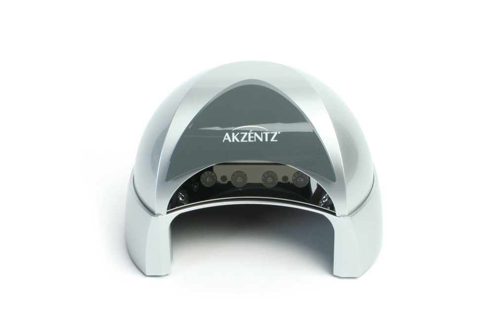 """<p>The four-finger LED lamp from <a href=""""http://www.akzentz.com/"""">Akzentz</a> is designed for rapid amd efficient curing. Ten bulbs guarantee years of reliable performance without variation in curing time or quality. Timer settings vary between 5, 20, and 30 seconds. A patented eye shield limits light exposure.&nbsp;&nbsp;&nbsp;&nbsp;</p>"""