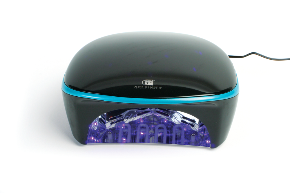 """<p>The Gelfinity 30-watt UV/ LED Lamp is a powerful lamp designed to work perfectly with any Gelfinity hard or soak-off gels from <a href=""""http://kupainc.com/"""">KUPA</a>. The built-in timer allows for 10-, 30-, 60-, or 90- second cures and includes an automatic motion&nbsp;sensor that will activate the light when clients place their hands into the lamp. The lamp comes complete with auto switching transformer that is compatible with&nbsp;both 110- or 220-volt power sources.</p>"""