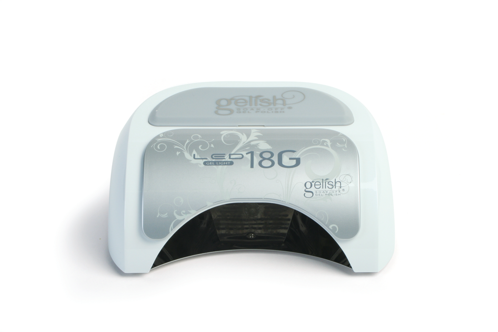"""<p>Created with Safelight Technology, the <a href=""""http://gelish.com/"""">Gelish</a> 18G LED light protects clients&rsquo; and nail technicians&rsquo; eyes by limiting light exposure. Built with 18 2-watt LED lights, the lamp also has a removable wrist guard and removable magnetic tray, making it easy to clean and pedicure friendly.</p>"""