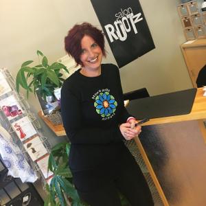 Salon Rootz director of marketing Jennifer LeBlanc calls clients each morning to fill open slots...