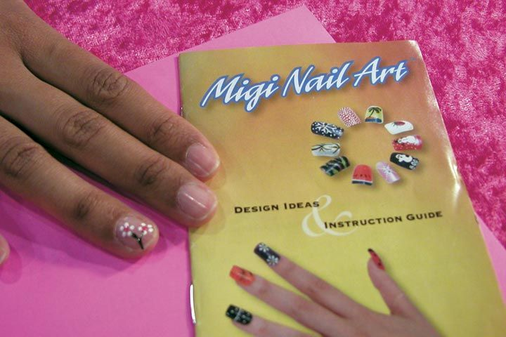 <p>Managing editor Sree Roy shows off her fingernail, freshly painted with a Migi Nail Art Polish Pen.</p>