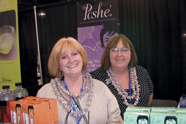 <p>All smiles, Sarah Bryson (left) and Vickie Maher work the Posh&eacute; booth.</p>