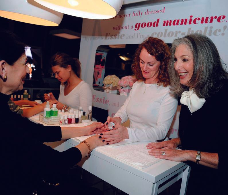 <p>Essie Weingarten (right) makes an appearance at <strong>Essie&rsquo;s </strong>pop-up salon, where Sand Tropez was an oft-requested hue. &ldquo;We saw a lot of unusually colorful and bright collections for fall &mdash; oranges, reds, greens and blues,&rdquo; Weingarten says. &ldquo;As a result, we are seeing a lot of neutral nails that are made bold through interesting textures.&rdquo;&nbsp;&nbsp;&nbsp;</p>