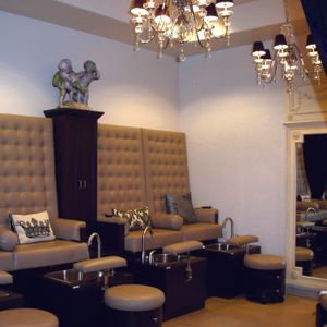 The pedicure area is tucked away in the back of the salon allowing technicians to lower the...
