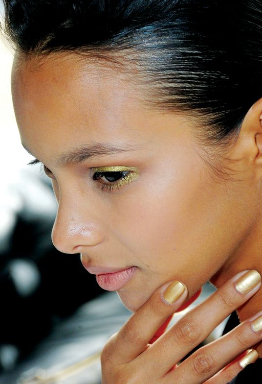 """<p class=""""TDP"""">To accessorize Alexandre Herchcovitch&rsquo;s opulent collection, <strong>CND</strong>&rsquo;s Wanda Ruiz polished nails in Gold Chrome topped with Air Dry Top Coat, which was coupled with gold eye shadow and metallic pieces on the runway amidst earthy neutrals, dusty rose, and flesh tones. <em>Photography courtesy of CND</em></p>"""