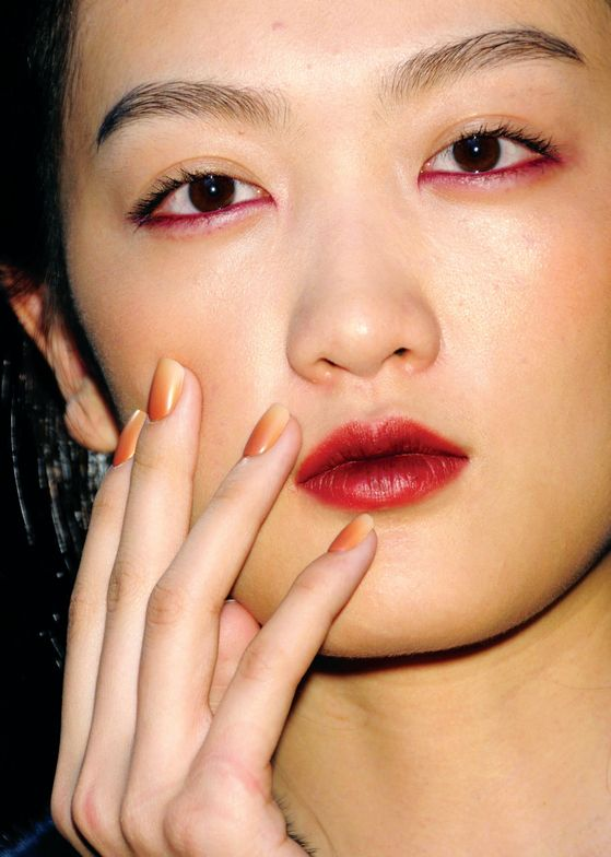 <p>At Christian Cota,&nbsp;Candice Manacchio created an ombr&eacute; effect with <strong>CND</strong> Colour in Chocolate Milk&nbsp;and Putty, which can be done at the salon by using a makeup sponge to apply&nbsp;Chocolate Milk&nbsp;from the cuticle to halfway down the nail, then adding Putty from half way to nail end and finishing with CND Super Matte Top Coat&nbsp;to combine the two colors while still wet.&nbsp;<em>Photography courtesy of CND</em></p>