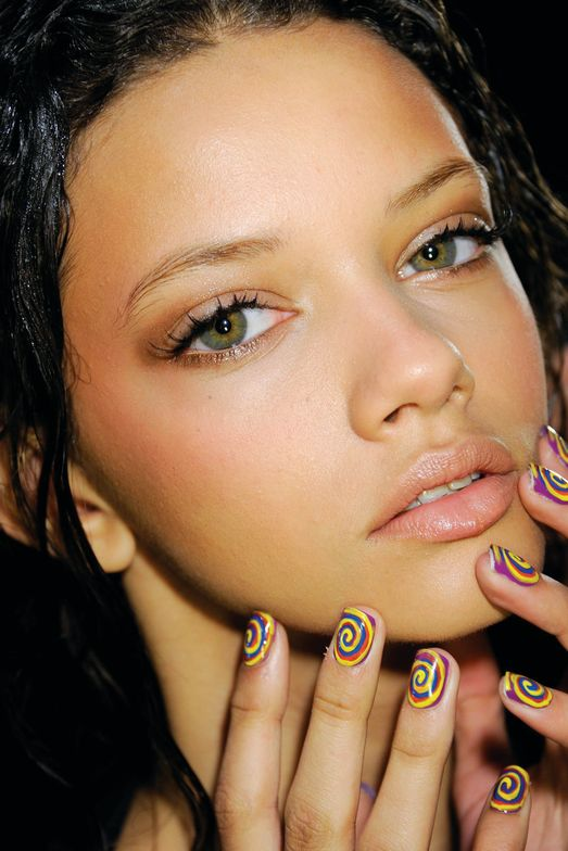 <p>At Nicole Miller, <strong>CND</strong>&rsquo;s Wanda Ruiz created hypnotic swirls of&nbsp; Plumville, Electric Orange, Bicycle Yellow, and Anchor Blue, a look that can be replicated with a toothpick (or a detailing brush) and some patience. <em>Photography courtesy of CND</em></p>