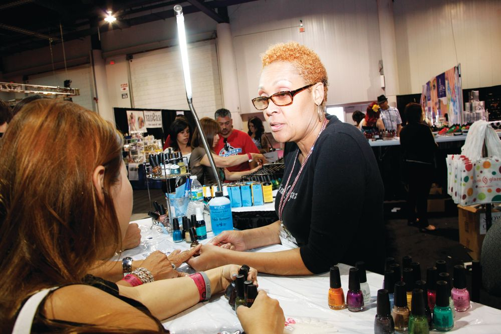 <p>China Glaze educator Lynn Long entertained show attendees with the use of the Magnetix magnetic polish line.</p>