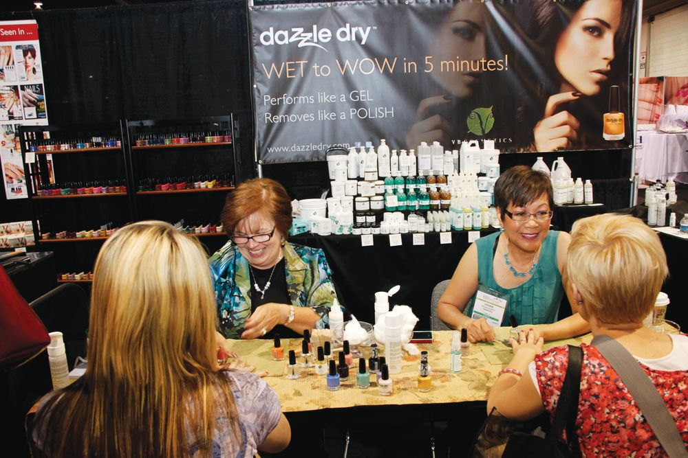 <p>Dazzle Dry sales/marketing manager Kathy Bachi (left) and Dr. Vivian Valenty demonstrated the use of their Dazzle Dry polish products.</p>
