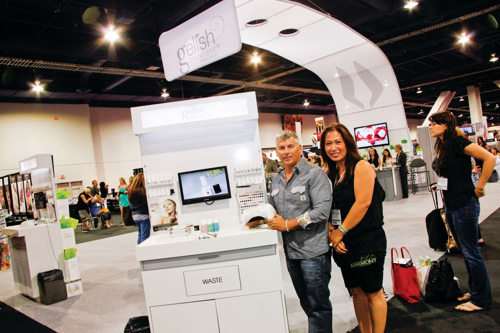 <p>Hand &amp; Nail Harmony CEO Danny Haile and education manager Thao Nguyen pose next to the new Gelish 18G LED Lamp.</p>