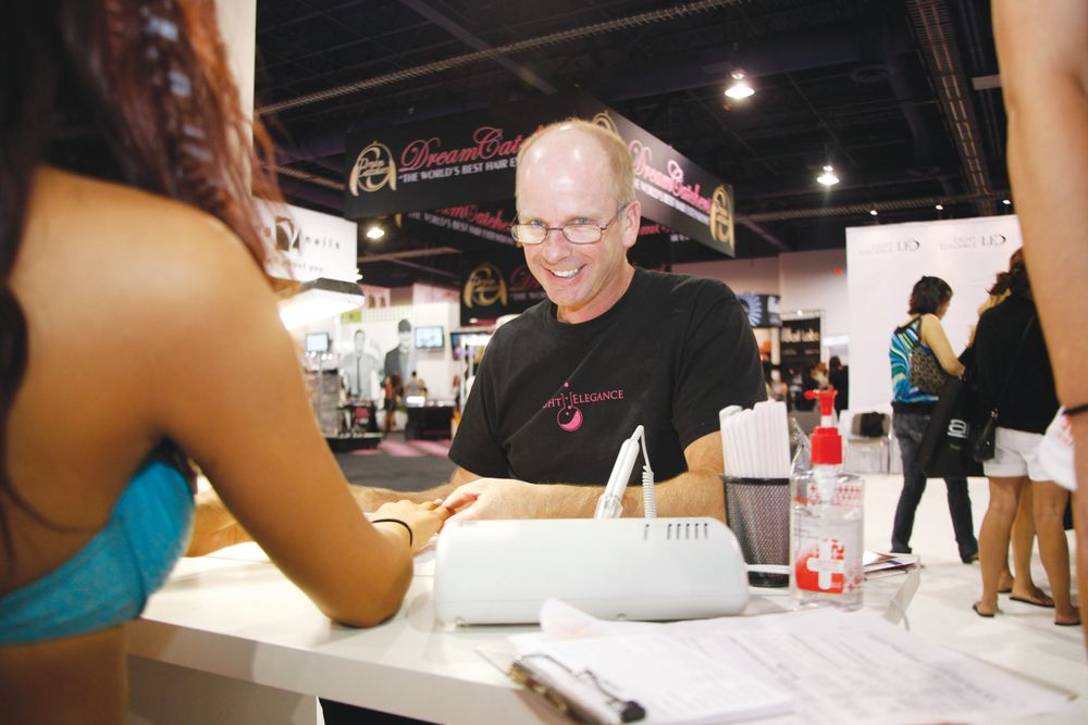 <p>Light Elegance CEO Jim McConnell wasn&rsquo;t too shy to demo his latest glitter gel on his neighboring booth exhibitors.</p>