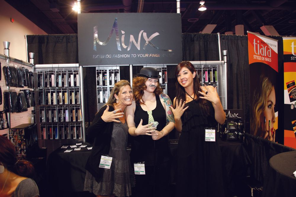 <p>Having fun at the Minx Nails booth, Jen Vellom, Crystal Rice, CMP, and Roslynn Reynoso did demos at the booth.</p>