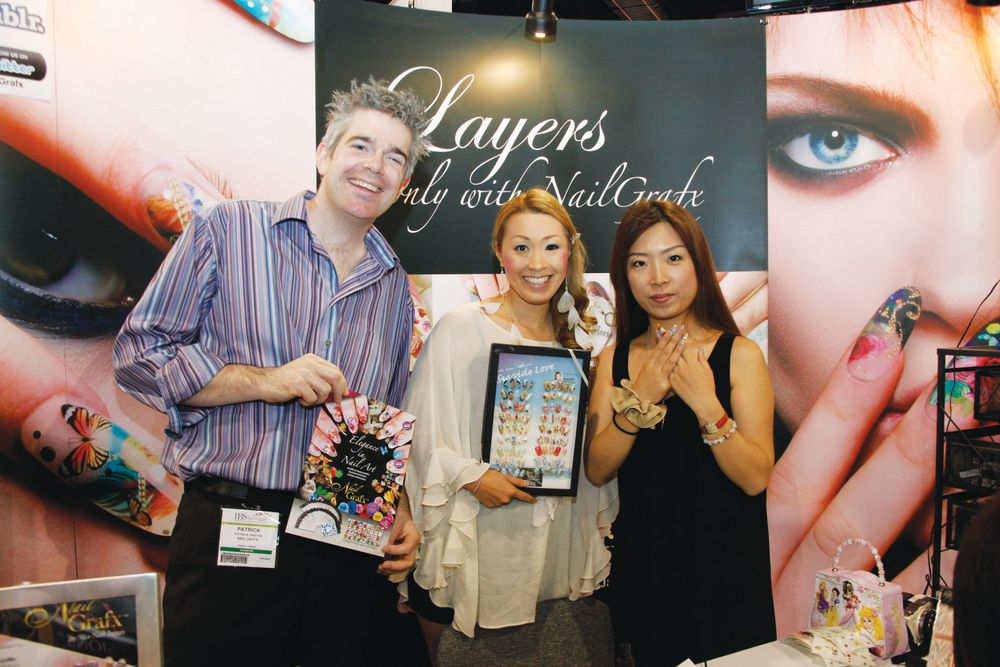 <p>NailGrafx marketing manager Patrick Griffin, educator Mami Griffin, and Japan sales director Hiromi Kanaguchi promoted their extra thin adhesive nail ornaments.</p>
