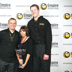 The winner in the nail artistry category, Teanna Licorish, poses with Nick Arrojo (left) and...