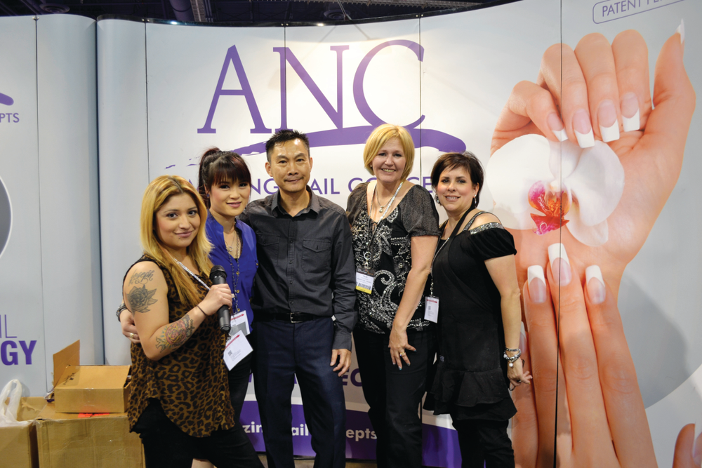 <p>The team at Amazing Nail Concepts takes time out from demoing products to take a group photo.</p>