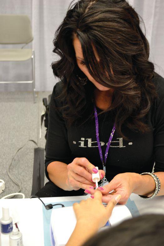 <p>Allison Ross of IBD demonstrated multiple nail art designs using gel-polish.</p>