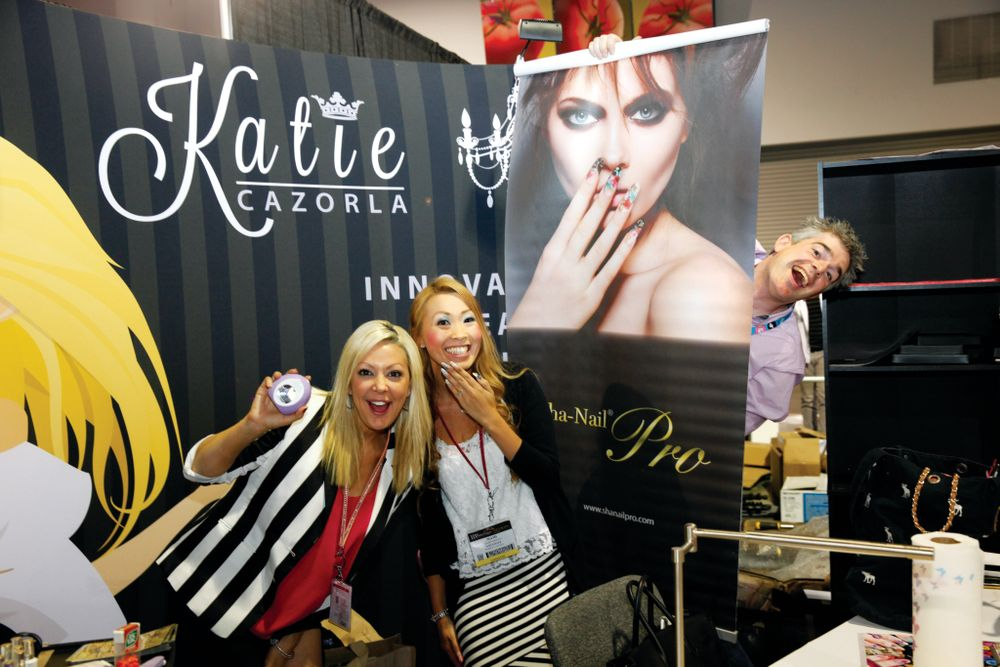 <p>Katie Cazorla and Mami Griffin had too much fun at their booth, where they promoted NailGrafx and Color Flash Nails (we see you, Patrick Griffin).</p>