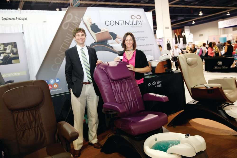 <p>Continuum&rsquo;s Tony Galati and Dana Carini promoted the Vantage and Vantage Plus spa chairs that can come in custom colors (like the purple chair shown here).</p>