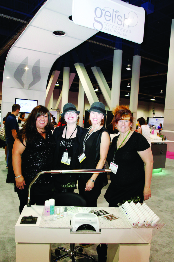<p>MaeLing Parrish, Sandy Borges, Danielle Candido, and Jeanine Zagerman set up products on a custom-made table by LaBelle that houses Gelish&rsquo;s 18G LED lamp.</p>