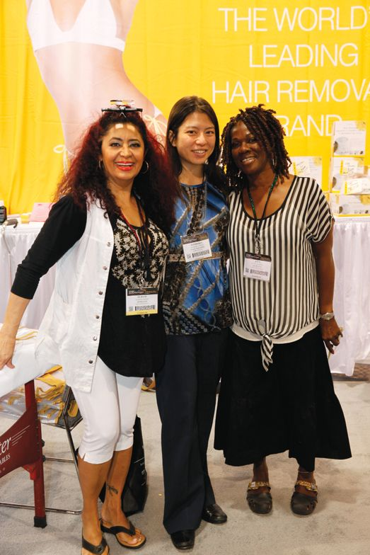 <p>VietSALON associate editor Kim Pham (center) is flanked by Kym Jackson (right) and Elham Jazab (left), who demonstrated Gigi Brazilian Body Wax on Pham&rsquo;s eyebrows.</p>