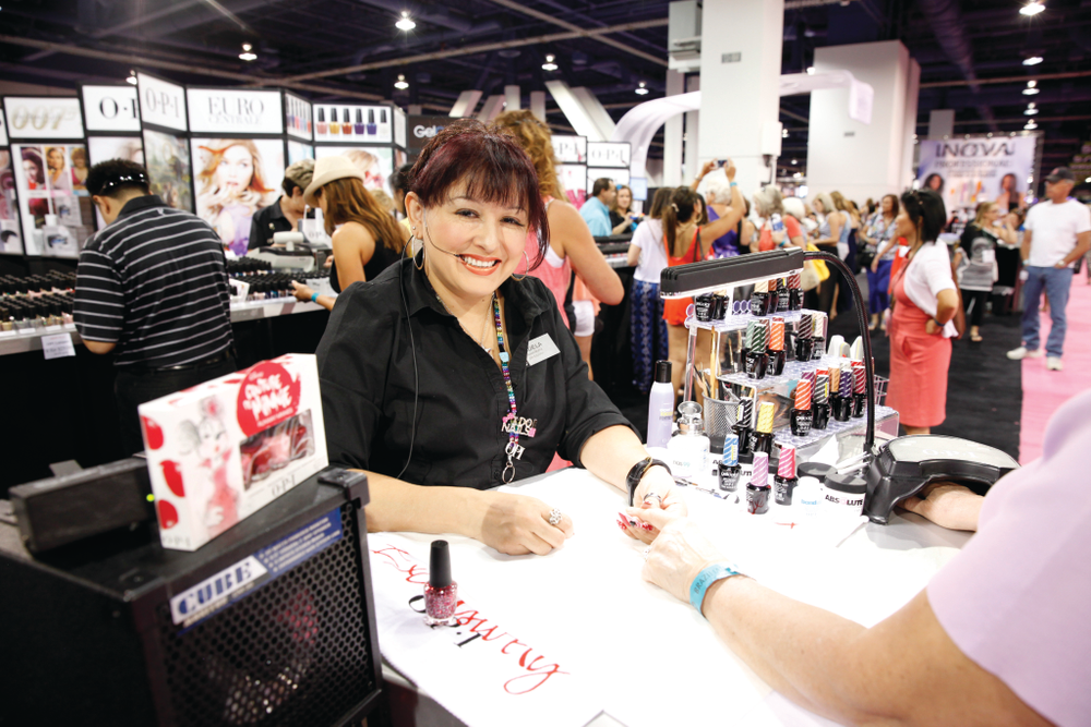 <p>Adela Munoz had fun painting with the Couture de Minnie collection at OPI&rsquo;s booth.</p>